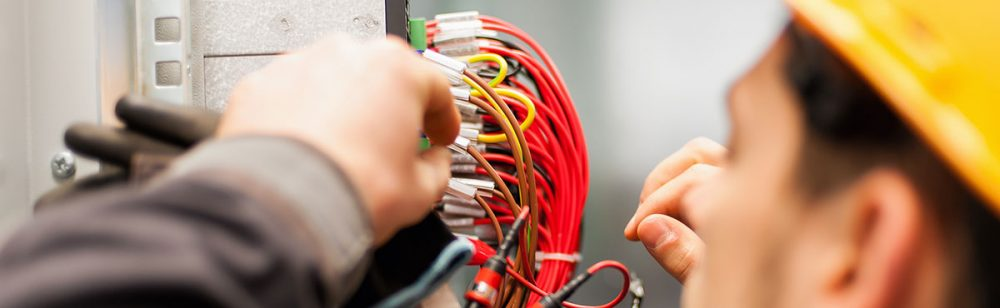 Image of electrician working on panel